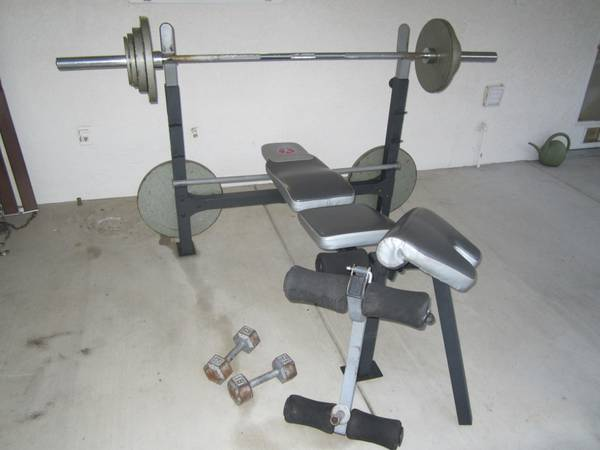 Marcy weight bench w olympic bar and plate set - $300 (nw bakersfield)