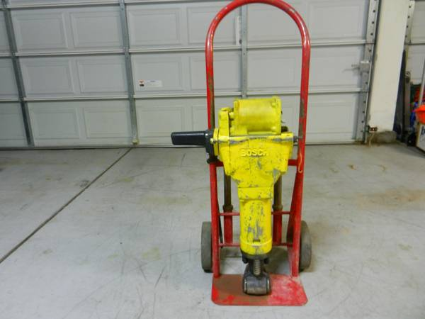 Bosch Brute Jackhammer For parts wcart and 3 attachments - Parts - $175 (Reno )