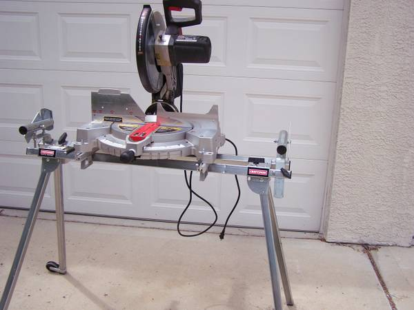 CRAFTSMAN 12 COMPOUND MITRE SAW WITH LASER TRAC AND STAND - $290 (RENO)