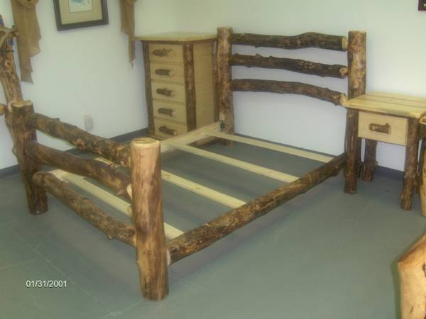 Aspen log bed, queen size, factory new - $599 (Wades Furniture)