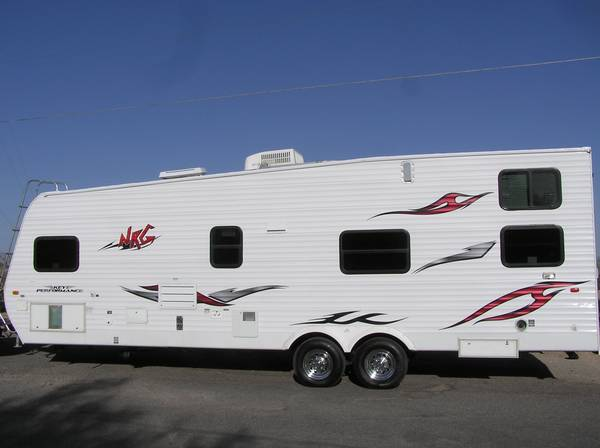 2007 kEYSTONE NRG-FRONT QUEEN-DUAL REAR BEDS-EXC. COND. - $15000 (FIRM -GILBERT AZ)