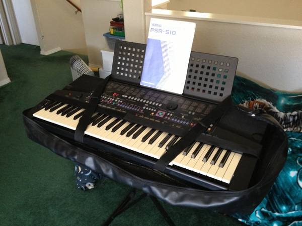 YAMAHA PSR-510 WITH STAND - $120 (Flagstaff)