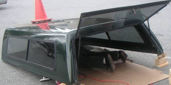 SNUG TOP CAMPER SHELL FOR A 1999-2012 FORD LONG BED PICKUP - $899 (NEVADA CITY, CA. 95959)