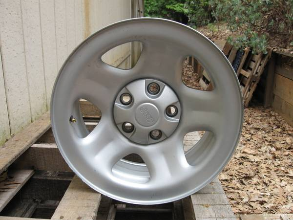 Jeep Wrangler TJ alloy rims tires - $100 (Georgetown)