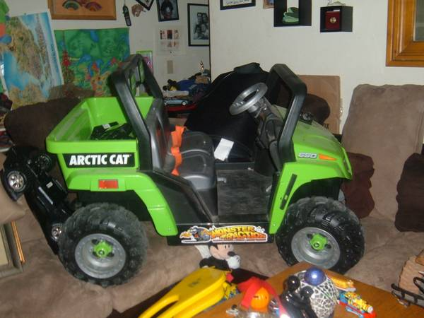 POWER WHEELS (GREEN)ARCTIC CAT MONSTER TRACTION - $100 (SUMMERLINPECOLE RANCH)