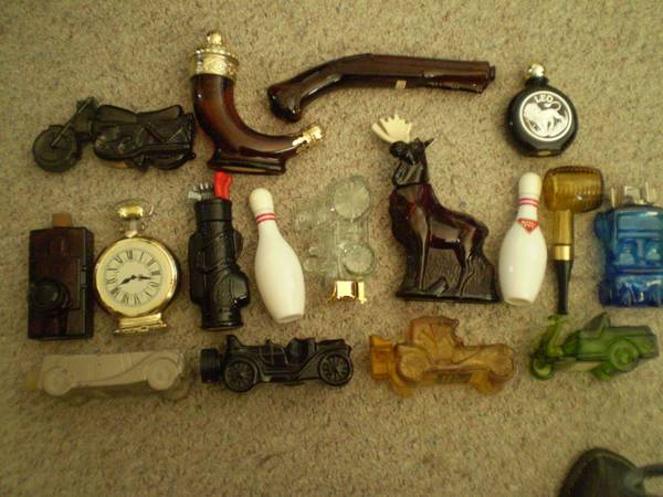 Avon Bottles Decanters Cars Guns Golf Moose Motorcycle Clock - $2 (1431 E Charleston)