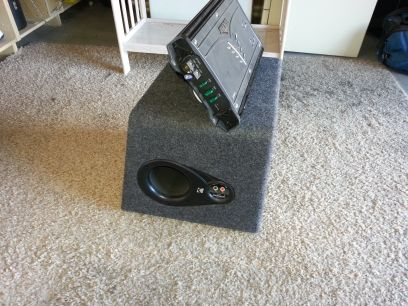 Kicker 7005 and L3 12 in factory enclosure - $450 (Henderson)