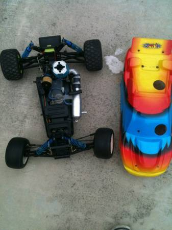 XTM xcellerator rc car loads and loads of spare parts - $150 (Laguna hills)