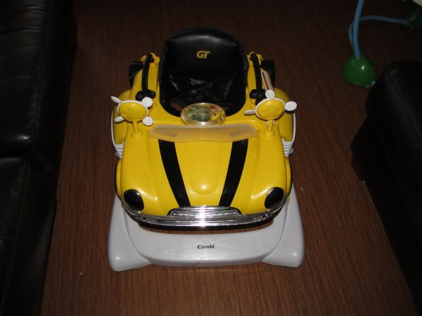 just reducedcombi all in one activity car bouncer and walker (yellow) - $45 (newport beach)
