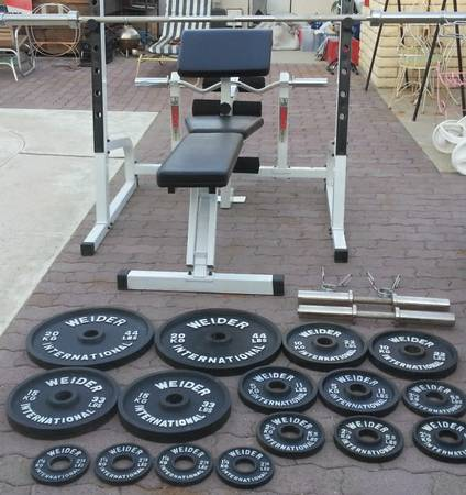 300lb Olympic weight set- squat rack- weight bench- curl bar-dumbbells - $450 (palm springs)