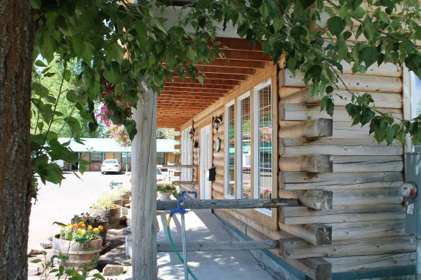 Motel and log home for sale -- trade ok, owner carry --