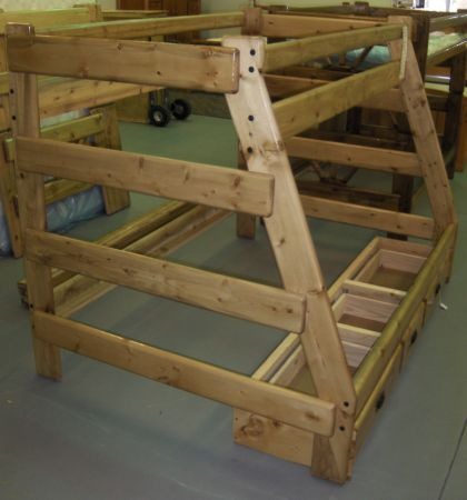 NEW wood bunk bed, twin over full - $325 (Wades Furniture)