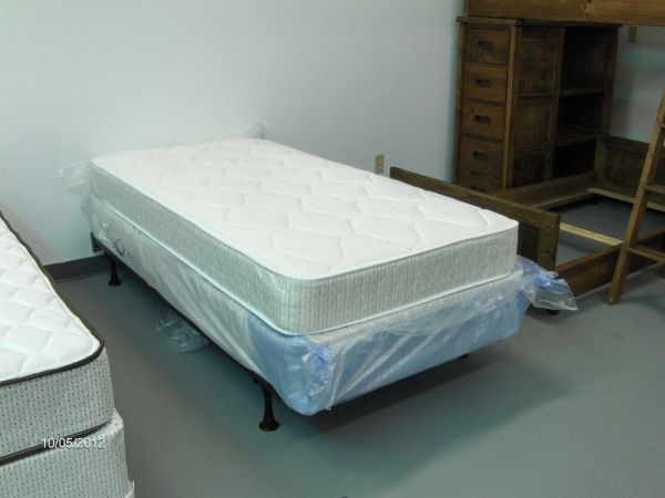 NEW twin size white mattress - $95 (Wades Furniture)
