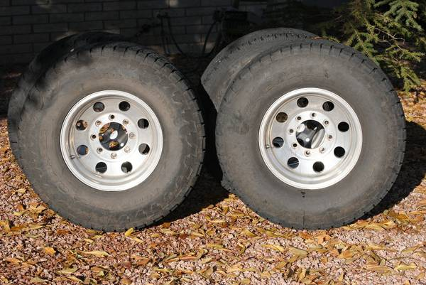 Ford Super Duty - Eagle Alloy 8-lug wheels with 30570R16 tires - $270 (Eagar)