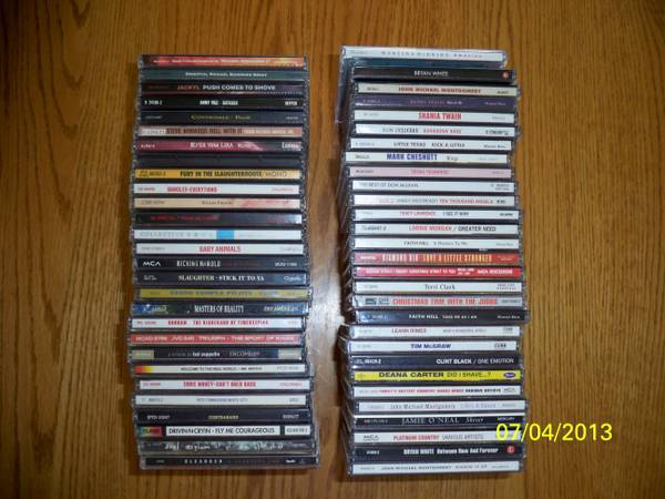 LOT OF 56 CDS - 27 ROCK, 29 COUNTRY - $40 (MESA)