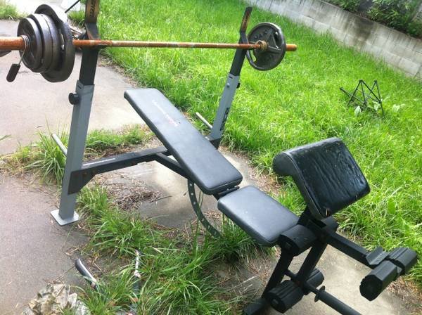 Weider Bench press weight bench with olympic bar and weights - $100 (SLO)