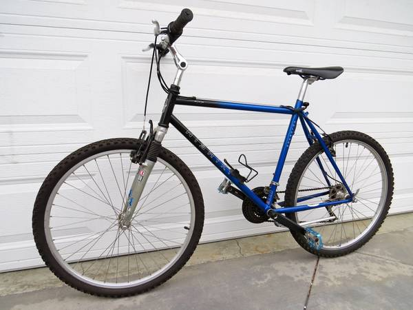 FABULOUS ROYAL BLUE NISHIKI COLORADO MOUNTAIN BIKE WITH SHOCKS - $225 (VENTURA)
